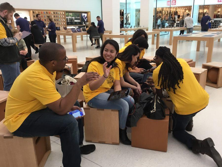 Students+of+Advancing+with+Apple+work+on+projects+assigned+during+field+trip+to+Apple+Store.