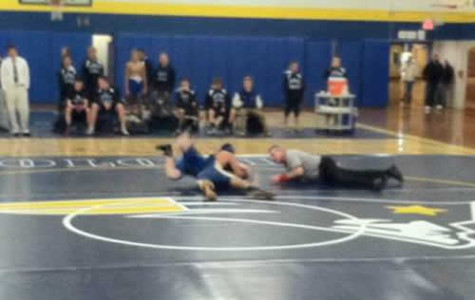 Wrestling loses to Metuchen at home