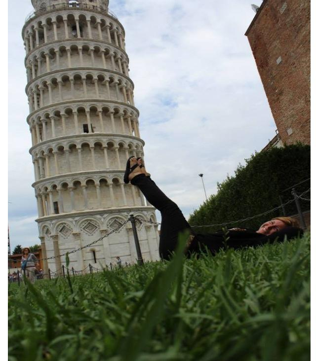 Showing her quirky personality, Mrs. Jenna Tanis, Special Education Teacher at CHS, pushes with all her might against the Leaning Tower of Pisa in Italy.