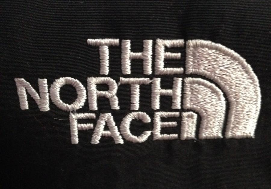 The+North+Face%27s+half+dome+logo++can+be+seen+on+many+high+school+students+and+teacher%27s+coats.