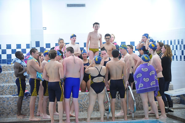 The+swim+team+gets+roweled+up+for+the+meet+with+a+loud+cheer.+