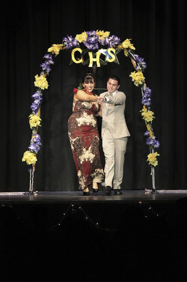Seniors Selah Sassone and Justin Deak modeling beautiful fashions.