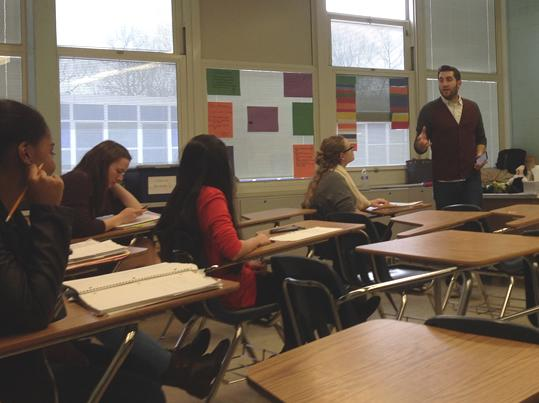Chris Rockwell speaking to CHS poetry club members about cliches.