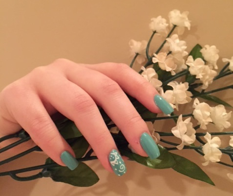 Trendy spring crystal manicure by Nail Studio in Colonia, New Jersey.