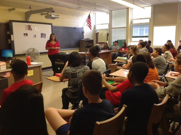 CHS's Student Assistance Counselor Ms. Giordano speaks to the freshman CCRA students.