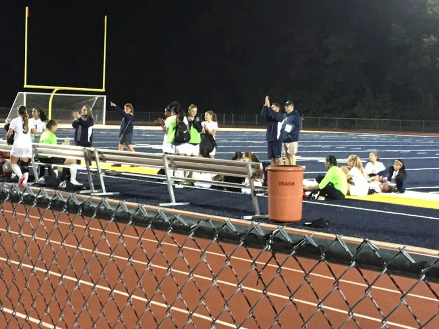 Colonia Girls Varsity Soccer taking a rest after their win.