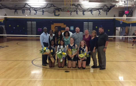 varsity senior girl volleyball players with their parents