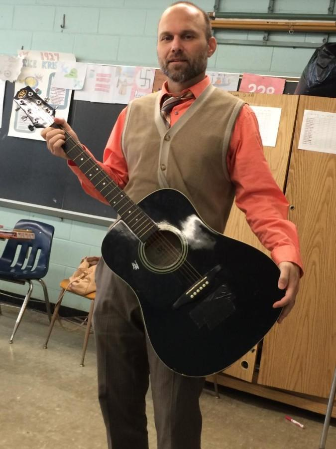 showing off his pretty guitar, Perrino poses wit his beauty