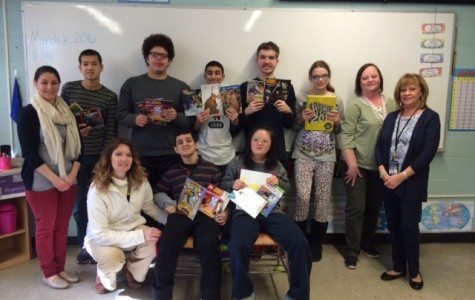 Scholastic donates books to adaptive learning class