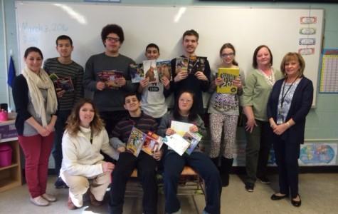 Scholastic donates books to adaptive learning class