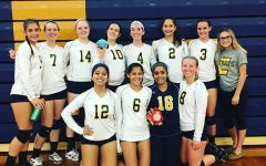 After successfully beating South Brunswick 2-0, the girls varsity volleyball team get together for a picture.