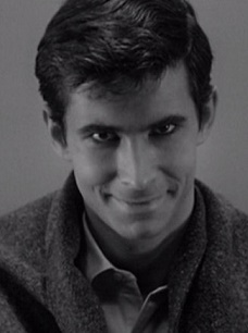 Sinisterly staring into the camera, Anthony Perkins as