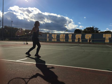 To prepare for the game, Melissa Ngai practices against a team member from Mother Seton.