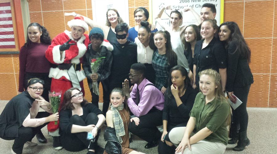 The cast of Colonia's Fall Showcase poses for a picture, after their opening night performance.
