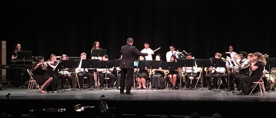 With a groovy beat, Jazz Band takes the stage and performs three songs.