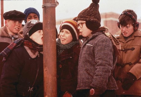 After Ralphie's friend gets his tongue stuck on a metal pole in the cold weather, a group of school boys, including Ralphie, gawk in amazement.