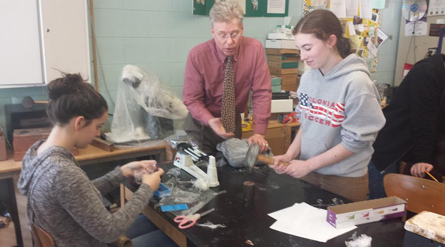 Inside room 126, Mr.Danch helps students Lauren Wright and Casey Mulrooney with their experiment.