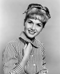 A young Debbie Reyonalds posing in black and white.