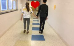 A high school couple walking hand in hand down the hallways of CHS.