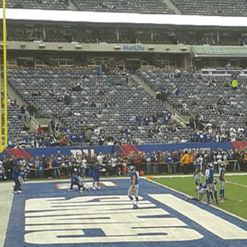 Before their game against the Dallas Cowboys, the New York Giants warm up on the field.