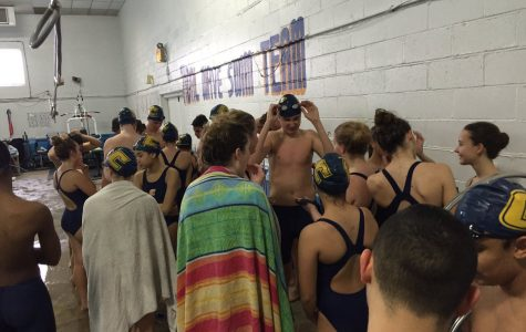 After the match, the Swimming Patriots come together and talk.