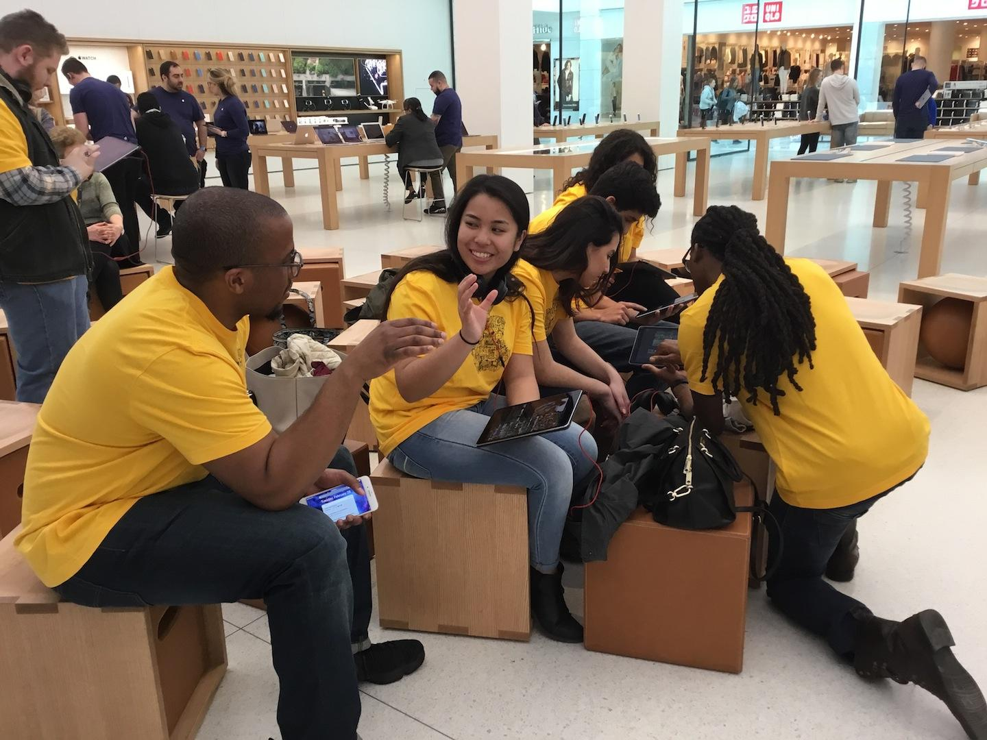 Students of Advancing with Apple work on projects assigned during field trip to Apple Store.