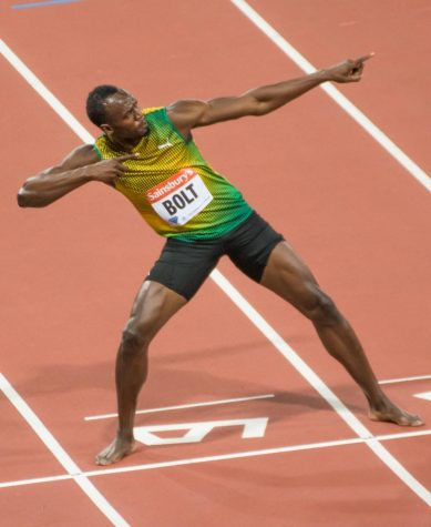 Usain Bolt breaks the world record in the 100m sprint