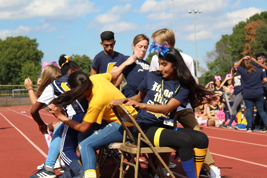 During musical chairs, finding a seat is a can be a challenge.