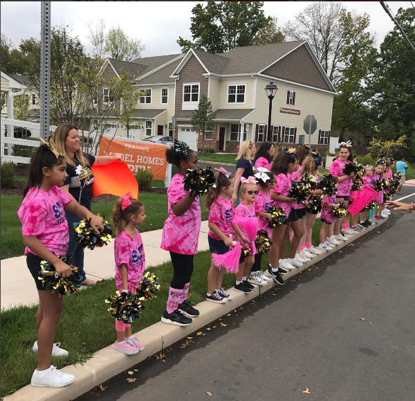 SJV cheerleaders encourage tired walkers to push the last 1/2 mile at last Sunday's breast cancer walk!  Frankie Brock