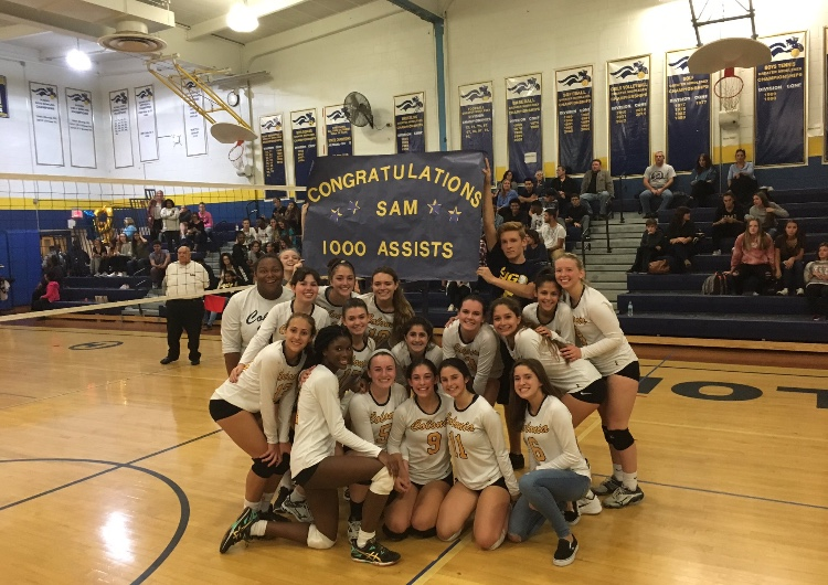 The girls varsity volleyball team with Samantha Ashton, who achieved her 1000th assist and made history.