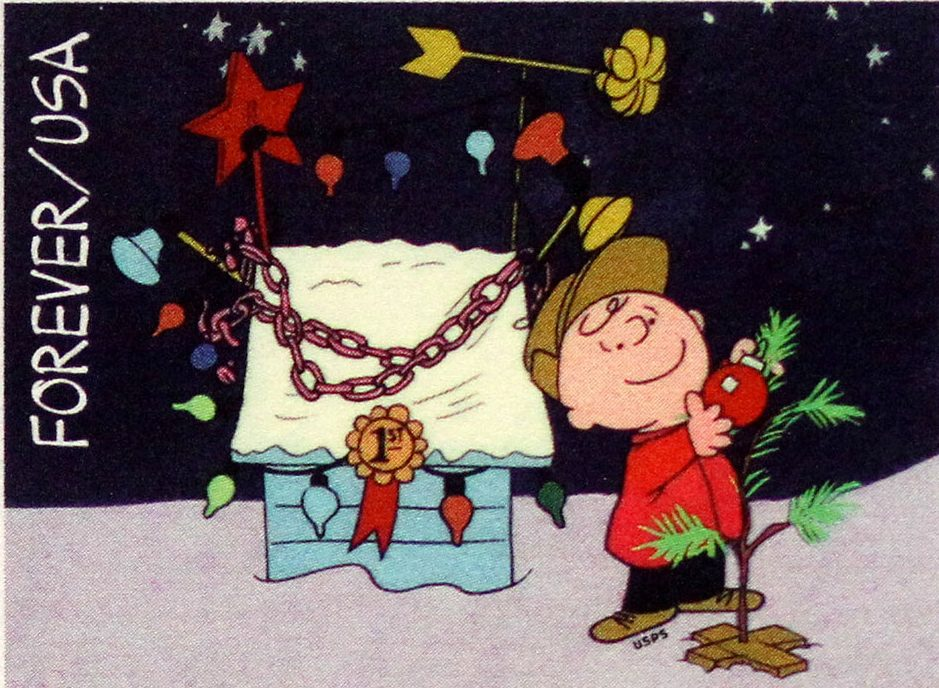 Charlie Brown is seen putting an ornament on a small tree outside, this was in the Charlie Brown Christmas special.