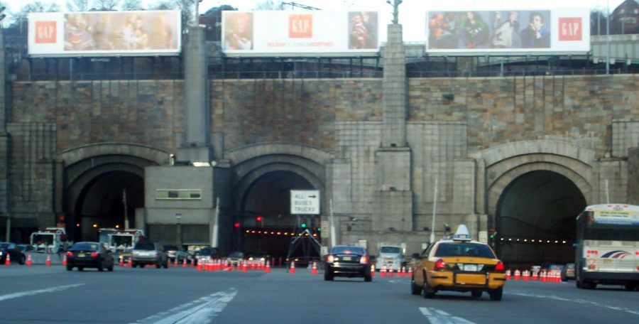 Zooming through the Lincoln tunnel thousands of cars travel via the tunnel everyday.