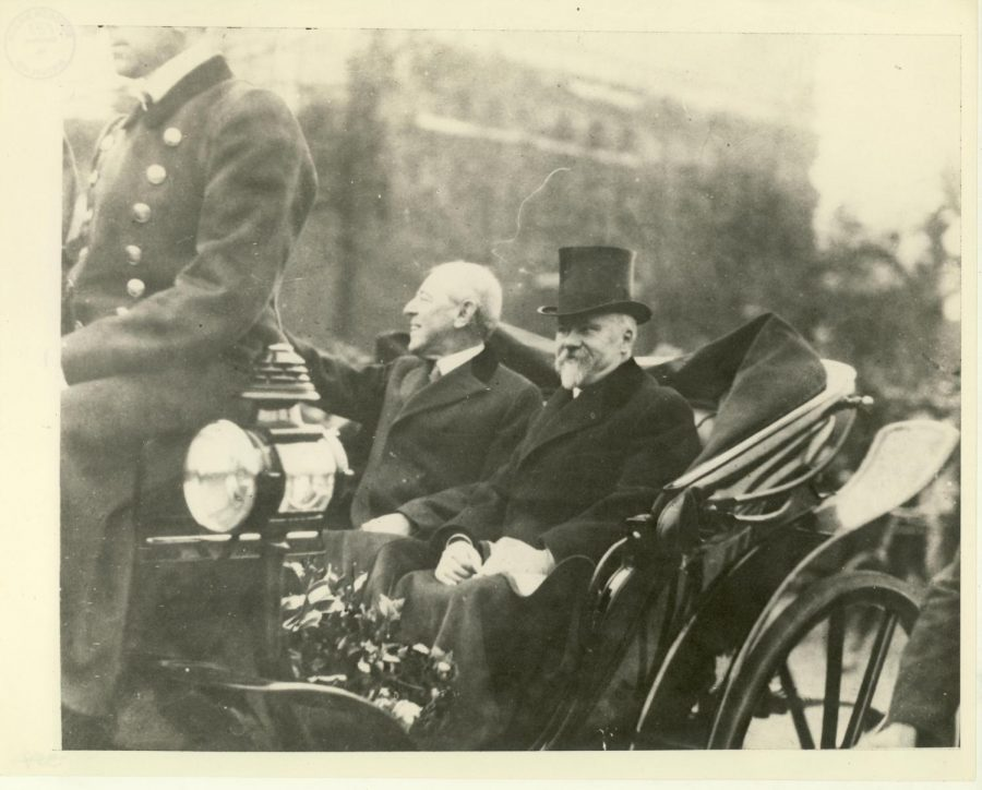 Riding through the streets of France President Wilson Sits beside President Poincare of France on their way to peace negotiations.
