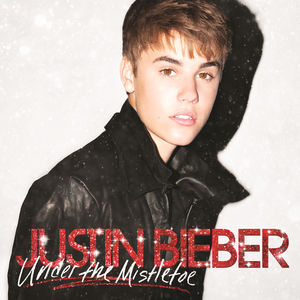 "photo via credit wikipedia Justin Biebers ""Under the Mistletoe"" Christmas album cover."