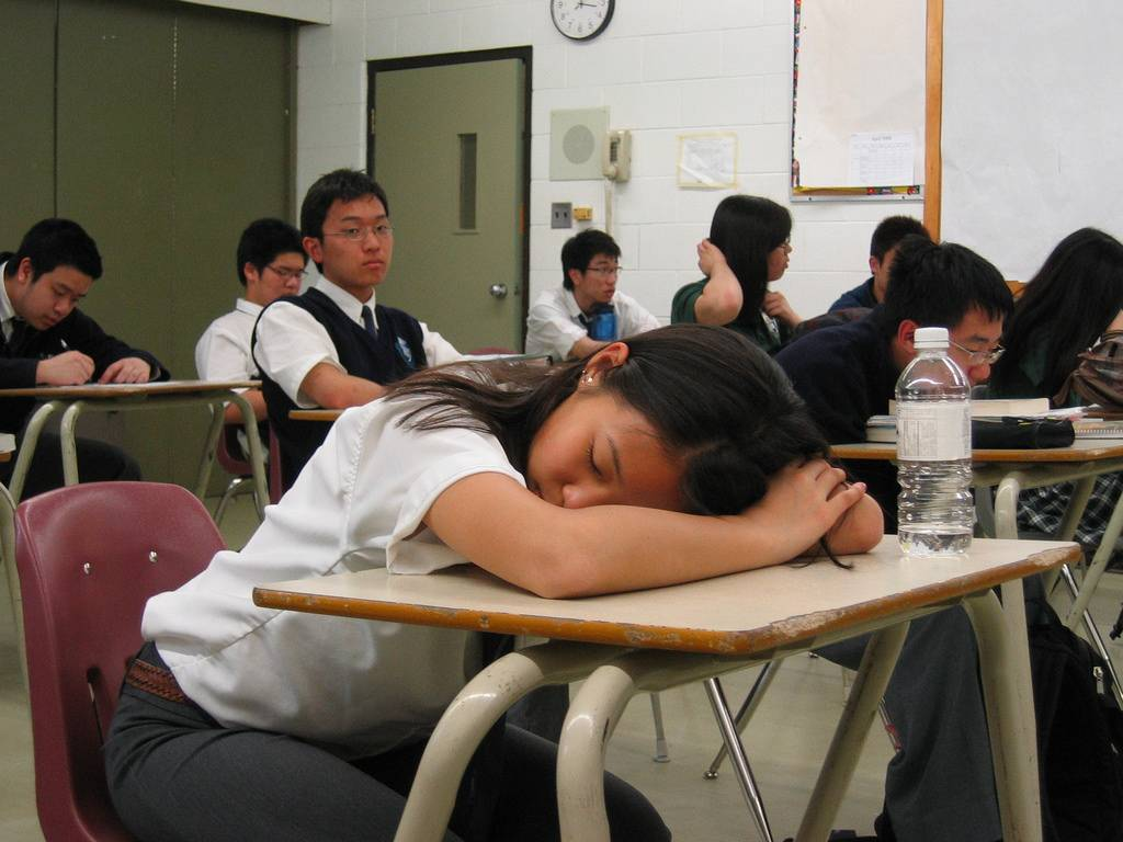 Here seen is a student asleep in class, where she should be learning. This could be a result of staying up late on social media or doing an assignment.