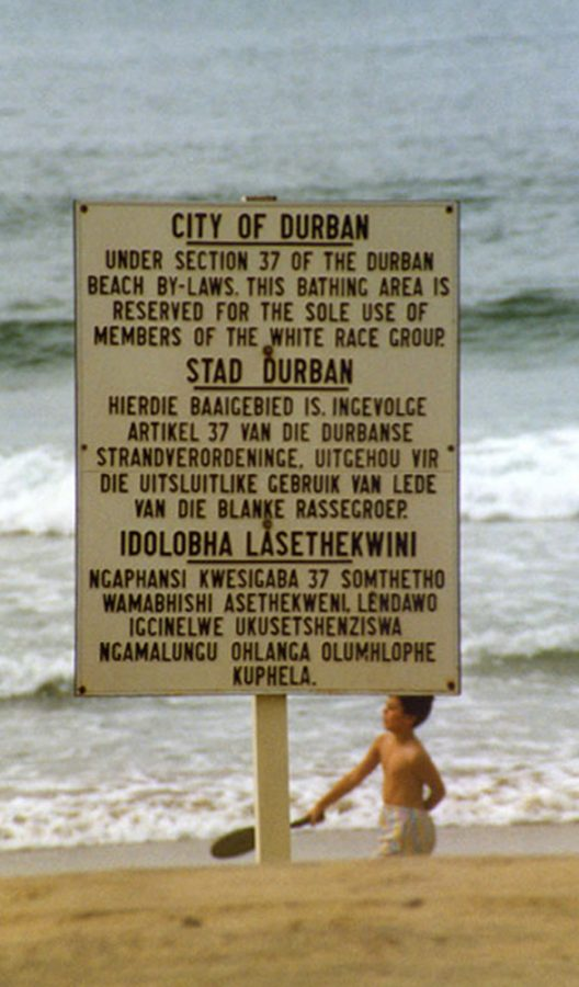 Planted in a South African beach this sign declares the systematic segregation of Apartheid.