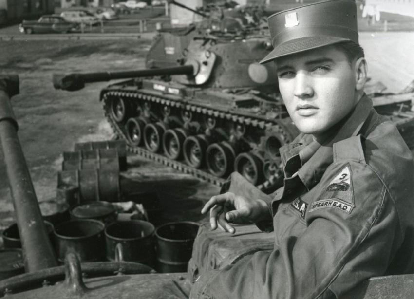 Sitting in a German battlefield, Elvis Presley fights in World War II