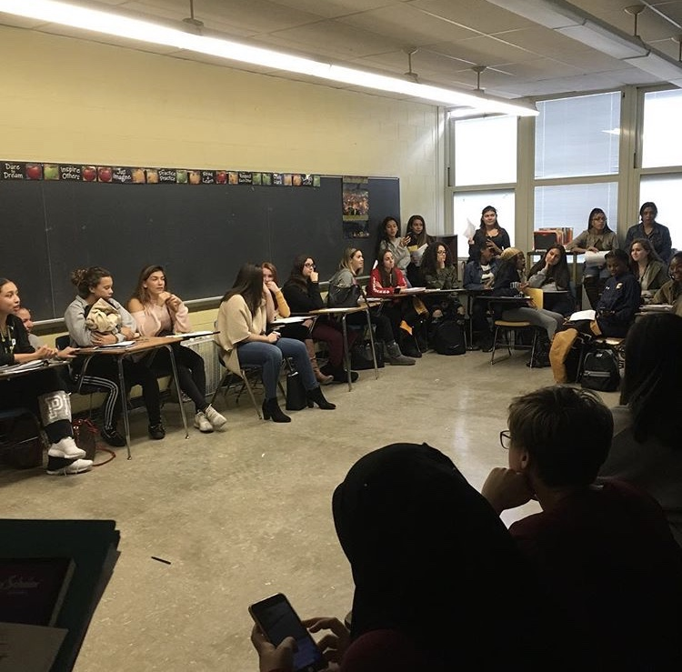 Girl Up! members gather to discuss important issues facing women in today's world.