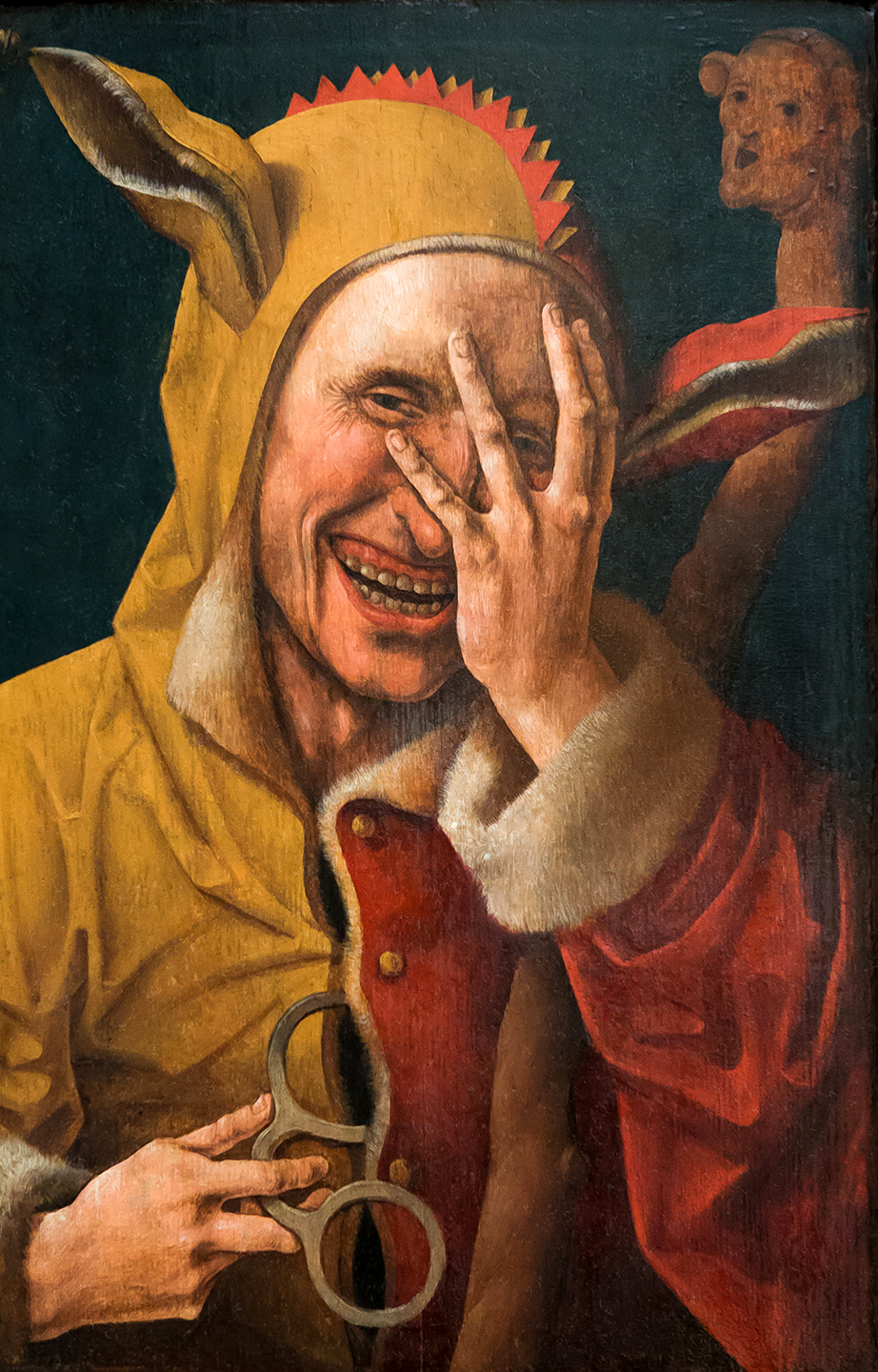 A Laughing Fool. Netherlandish oil painting (possibly Jacob Cornelisz. van Oostsanen) ca. 1500.