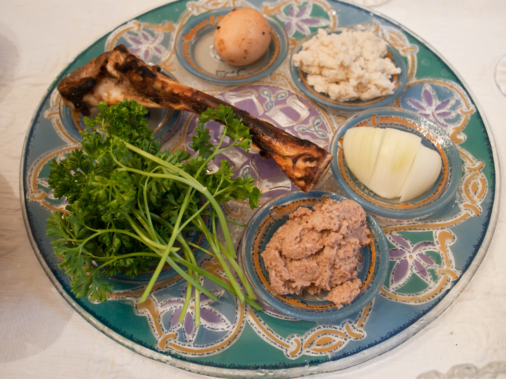 When celebrating Passover, a traditional seder plate includes matzah, the zeroa (shankbone), egg, bitter herbs, charoset paste and karpas vegetable.