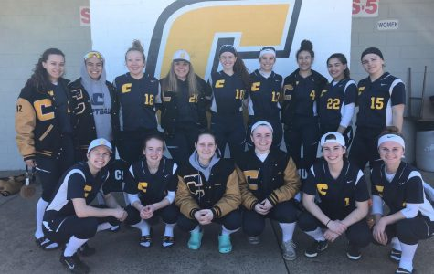 All smiles, The Colonia Girl's Softball team celebrates their opening day victory with a team photo