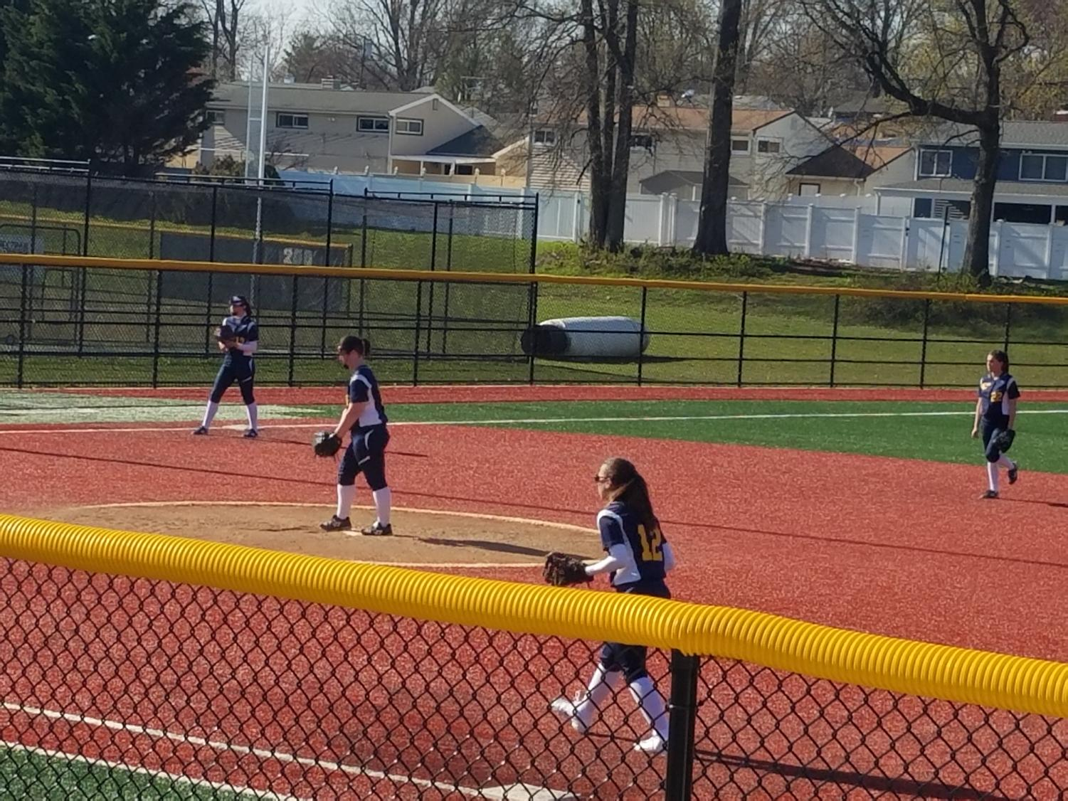 Ready to play, the Colonia Softball team prepares for the ball to come their way against Perth Amboy.