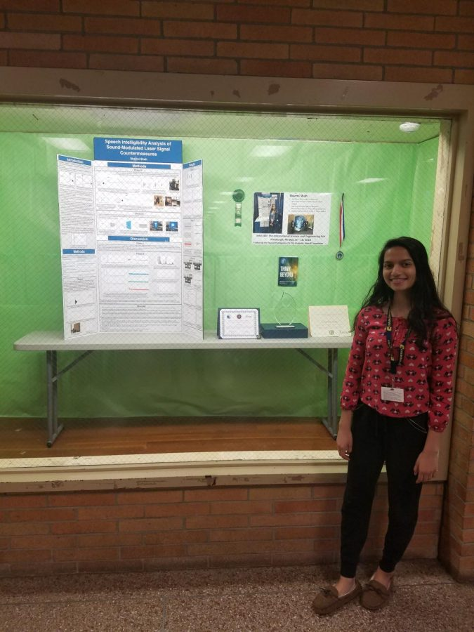 Competing+at+ISEF%2C+Sharmi+Shah+poses+with+her+award+winning+project.