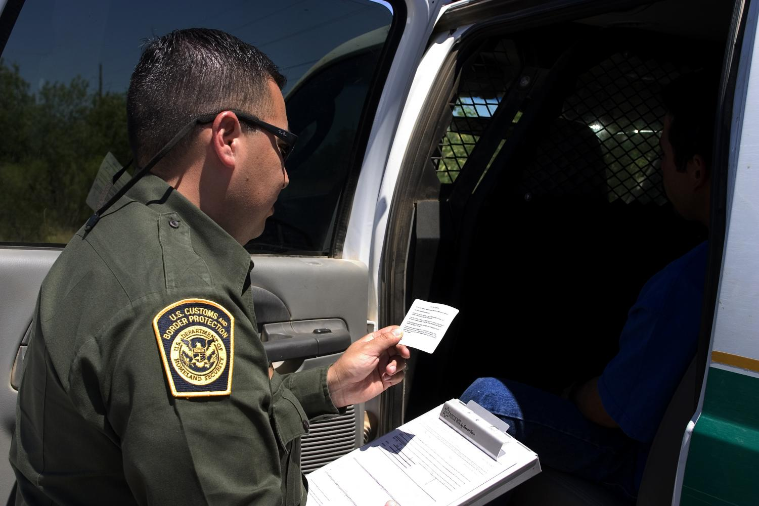 Due to the events of Miranda v. Arizona, The Border  patrol officer must read the Miranda Rights to his suspect.