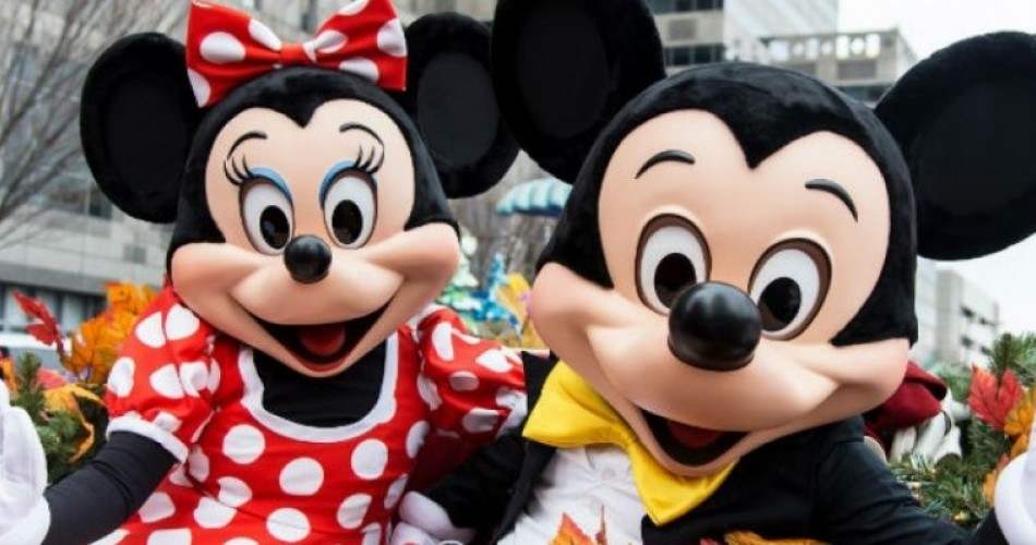 Mickey and Minnie Mouse outside.