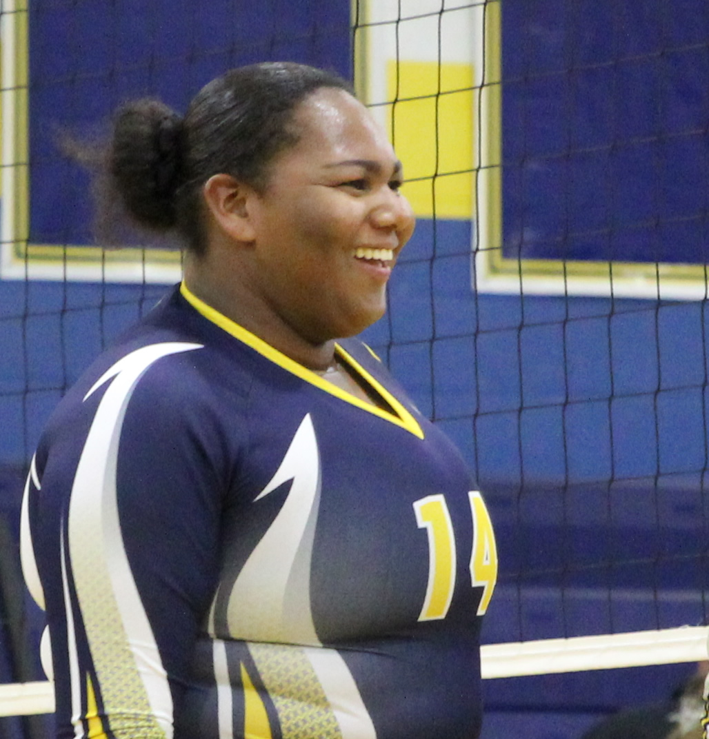 Despite health issues, Tiffany Rolon-Locus takes an active role on this years varsity volleyball team.