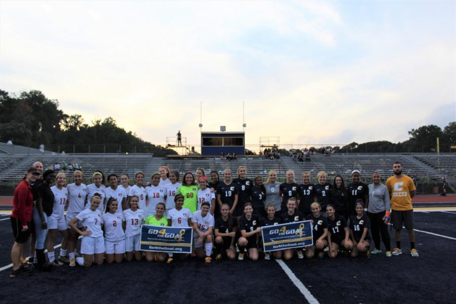 The Woodbridge Girls Soccer Team (left) and Colonia Girls Soccer Team (right) took a picture before the game,