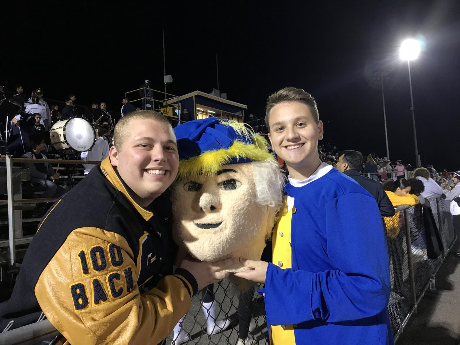 Because of the Homecoming game, Piccinnini (left) decided it was a good time to visit Colonia High School to see how Benson (right) was doing as the mascot.
