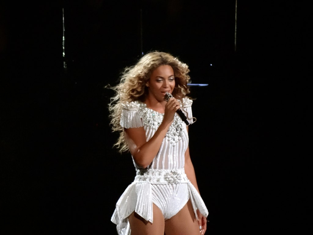 Singing from her album, Beyonce performs on stage
