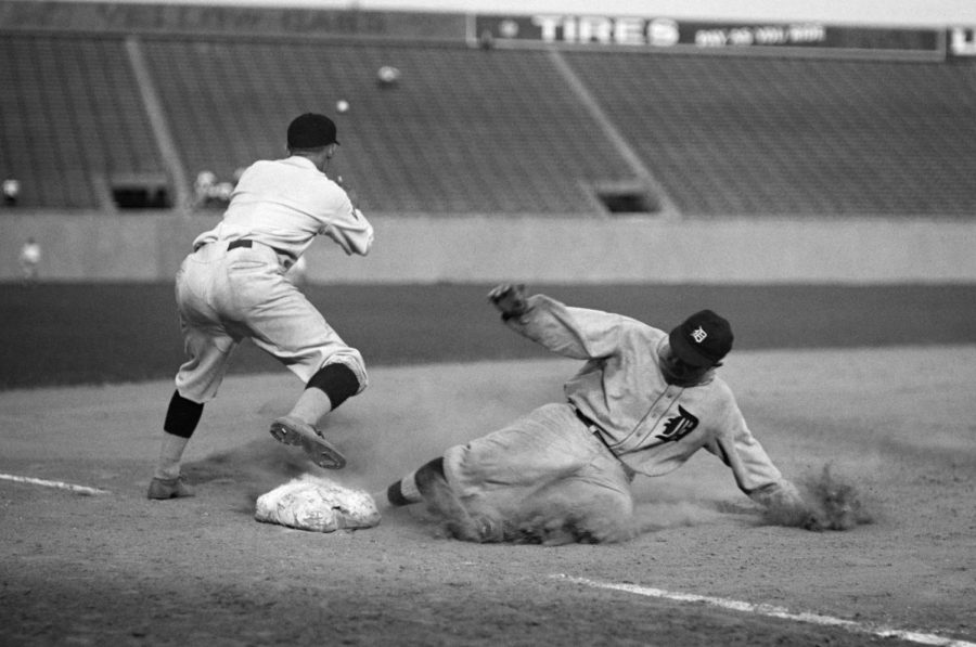 Seen here is late MLB legend Ty Cobb sliding into third base.